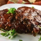 Slow Cooker Baby Back Ribs - Cooking baby back ribs in the slow cooker all day, gives you the possibility of glazing with sauce and having on the dinner table within half an hour of getting home from work!