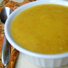 Roasted Acorn Squash Soup - Acorn squash is roasted and blended with onion, carrot, and garlic to create a smooth and delicious soup.