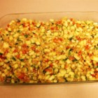 Zucchini Casserole I - Creamy zucchini casserole baked with herb stuffing, chicken soup, carrots and onions.
