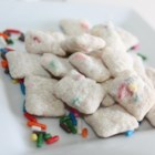 Confetti White Puppy Chow - A new twist on puppy chow includes white cake mix with sprinkles and vanilla almond bark for a festive, confetti white puppy chow.