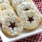 Cranberry Cornmeal Linzer Cookies - Cranberries and cornmeal give the traditional Linzer cookies a new taste and texture that is impossible to resist!