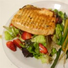 Grilled Arctic Char on Bed of Greens - Salt, pepper, olive oil, and a squeeze of lemon juice are all this warm arctic char salad needs. With fresh mango and strawberry slices over a bed of greens, this elegant salad is sure to satisfy.