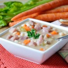 Navy Bean Soup with Ham - Use smoked ham hocks to add hearty flavor to a navy bean soup made from scratch.