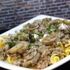 Poor Man's Stroganoff - This budget-friendly recipe turns ground beef, mushrooms, and sour cream into a tasty topping for egg noodles with a bit of Greek seasoning.
