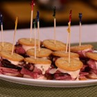 RITZ Pastrami and Corned Beef Mini Sandwich, created by Carnegie Deli - This recipe is a bite-sized version of Carnegie Deli's most popular menu item, the Woody Allen Sandwich.  Only a slight departure from the monster-sized menu staple, these RITZ mini sandwiches are flaky, delicious and fun to prepare.  Using Carnegie Deli's signature ingredients like Pastrami, Corned Beef, and homemade Russian dressing, your guests will feel like this party snack is straight from the deli counter.
