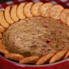 RITZ White Pizza Meatball Dip, created by Lombardi's Pizza - This recipe takes some favorite pizza toppings and turns them into a great party food! Served hot with RITZ Crackers, this creamy dip is easy to make. You can use pre-made meatballs or make your own, and with a few added Italian spices, this dip will become a staple at all of your get-togethers.