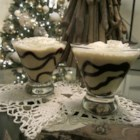 Nogtini - Make the nogtini your new traditional holiday drink. Shake eggnog, coffee-flavored liqueur, and vodka together and strain into a martini glass.