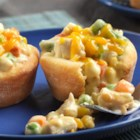 Mini Chicken Pot Pies - Thirty-five minutes is all you need to have these delicious mini pot pies on the table. Refrigerated biscuits form the crust for a flavorful chicken mixture and baked to golden perfection. They're so good you'll want to make them again and again!