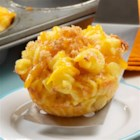 Mini Macaroni and Cheese Cups - Everyone loves macaroni and cheese, but it tastes even better when baked in individual muffin-pan cups. They are a fun and creative way to enjoy this classic comfort food.