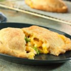 Cheesy Chicken and Broccoli Pockets - Your kids will love to wrap their hands around these delicious chicken and broccoli pockets! Refrigerated pizza crust forms the pockets that hold a hearty filling made with Cheddar cheese soup, fresh broccoli, cooked chicken and shredded cheese. They're so easy to prepare and the taste is simply irresistible.