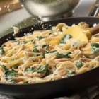 Simple Chicken Florentine Alfredo with Fettuccine - This easy-to-make, delicious pasta dish is ready in just 35 minutes! Tender chicken is coated in a rich, creamy Alfredo sauce and brightened with the addition of fresh baby spinach. Toss with fettuccine, and you've got a hearty meal that is guaranteed to please.