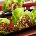 Asian Lettuce Cups - Perfectly seasoned ground turkey, hot and sour broth and fresh cilantro combine to make a flavor-packed filling to be served in tender lettuce cups. Finish with a sprinkle of chopped peanuts and green onions.