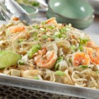 Shrimp Pad Thai Style - This Asian-inspired dish features sautéed shrimp, red pepper, onion and tofu paired with a savory broth, rice noodles and fresh bean sprouts. The flavors blend together perfectly for a main meal that's simply amazing!