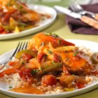 Hunter-Style Chicken - This one-pot dish features bone-in chicken breasts, peppers, onion and tomatoes simmered in a delicious sauce and served over a bed of brown rice. It's hearty, full of flavor and guaranteed to be a hit with your whole family!