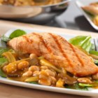 Grilled Salmon over Warm Tuscan Bean Salad - Flavorful grilled salmon is served over a delicious, warm bean salad. It's so easy to prepare, but the result is a restaurant-quality meal that's sure to impress!