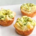 Fresh Herb Mini Tartlets - Bite-sized quiches are always a crowd-pleasing appetizer, and this delectable puff pastry version is easy to make and ready to serve in just 45 minutes.