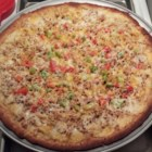 Tuna Pizza - A pre-baked pizza crust is topped with cream cheese, canned tuna, red onion, and mozzarella cheese, then baked until bubbly and golden brown.