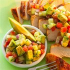 Cumin Rubbed Chicken with Avocado Salsa - Browned chicken breasts with cumin are served with a chunky salsa made with avocado, cucumber, tomato and fresh cilantro.