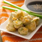 Tempura Fried Avocado Bites - Chunks of ripe avocado are coated with tempura batter, then fried in hot oil until crisp for a tasty dipping snack.