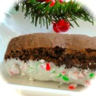 Shorecook's Chocolate Peppermint Biscotti - Chocolate peppermint biscotti get a coating of white candy and crushed candy canes for a tasty gift during the holidays.