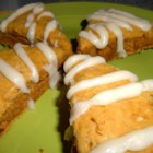 Pumpkin Scones with Brown Butter Glaze - Moist pumpkin scones are drizzled with brown butter glaze for a delicious seasonal treat.
