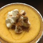 Mini Pumpkin Cheesecake - So tasty, cute, and totally YUMMY! These bite-size pumpkin cheesecakes have all the taste of the original versions, with no need for a traditional water bath.