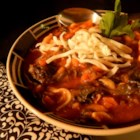 Chicken Vegetable Soup - This is a minestrone-like soup with frozen carrot slices, bow-tie pasta, chopped spinach and chicken simmered in a tomato and chicken broth.