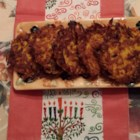 Tasty Potato Latkes - The flavor of traditional potato latkes is amped up with Cheddar cheese, garlic, cracked black pepper, and dry onion soup mix in addition to the usual ingredients of potatoes, onion, and eggs.