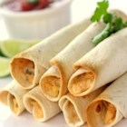 Great Chicken Taquitos - Homemade chicken taquitos filled with green onions, tomatoes, and plenty of seasoning are a great Mexican-inspired appetizer.