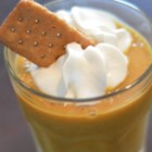 Easy Pumpkin Pie Smoothie - All the goodness of a pumpkin pie is blended into a smoothie and topped with crushed cinnamon graham cracker crumbs.
