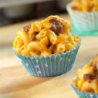 Mini Taco Mac and Cheese Cups - Tacos or mac and cheese tonight? You can have both when you serve these individual cups filled with family-favorite ingredients like ground beef, salsa, corn, elbow macaroni and Cheddar cheese. They're super delicious and sure to become a weeknight favorite!