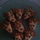 Reindeer Cookies - Shape sugar cookie dough into triangles and use pretzels for antlers and chocolate chips for eyes and nose for kid-pleasing reindeer cookies.
