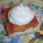 Peaches and Cream Pie II - Layers of cream cheese, whipped topping, peach gelatin and fresh peaches within a buttery, nutty crust.