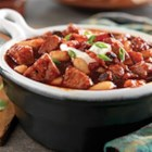 Smoky Pork, Bacon and White Bean Chili - This warm chili bowl made with white beans, crispy bacon and spiced pork tenderloin brings a savory twist to hearty comfort food.