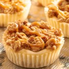RITZ New York-Style Mini Crumb Cheesecakes - A salty sweet combination of RITZ Crackers and New York-style crumb cheesecake, with RITZ Crackers as the cheesecake crust with RITZ Bits Peanut Butter Sandwich crackers in the crumb topping.