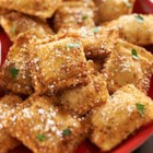 RITZ Fried Ravioli - Inspired by the mouthwatering appetizers served in Italian restaurants in New York City's Little Italy neighborhood, these cheese ravioli with a light, crunchy RITZ cracker crust and grated parmesan cheese will be a hit at any party.   Serve hot with marinara sauce for dipping for a delicious, quick and easy appetizer.