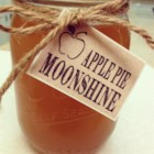Grandma's Apple Pie 'Ala Mode' Moonshine - Apple cider and apple juice are simmered with sweeteners and seasonings to blend with grain alcohol and vanilla-flavored vodka to make a cold, apple-flavored adult beverage.