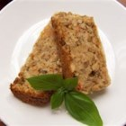 Imitation Meatloaf - Brown rice, lentils, bread crumbs, onions and tomatoes are combined with eggs and herbs and baked into a vegetarian version of a mealtime favorite.  Sprinkle loaf with shredded cheese and bake an additional 5 minutes, if desired.