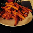Charlotte's Butternut Squash Fries - Butternut squash strips are roasted with garlic and thyme creating squash fries perfect for the Thanksgiving table.