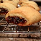 Sicilian Fig Cookies - A delicious fig-filled pastry.  You may substitute the figs with dried apricots or dates. Hazelnuts can also be used in place of the walnuts.