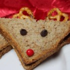 Reindeer Sandwiches - Transform a peanut butter sandwich into a reindeer sandwich using raisins, cherries, and pretzels as decorations for your favorite kids.