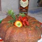 Simple Christmas Rum Cake - Use a boxed yellow cake mix to make this surprisingly easy but elegant rum cake soaked with delicious glaze.