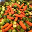 Baby Carrots And Brussels Sprouts Glazed With Brown Sugar and Pepper - The vegetables can be prepared the day before, and the glaze can be prepared up to 6 hours in advance.  The dish can then be completed in a few minutes while the turkey is resting.  It all looks so effortless. Originally submitted to ThanksgivingRecipe.com.