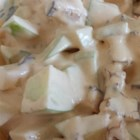 Apple Snicker Salad - Candy bars and apples are folded into a creamy mixture of pudding and whipped topping in this dish.