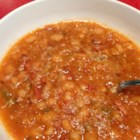 Navy Bean Soup I - A great soup to simmer all afternoon, full of tomatoes, onions, celery, ham, and spices.  This recipe makes eight to ten servings so make sure you have a large stock pot on hand.