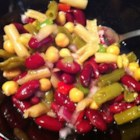 Best Bean Salad - Five cans of beans are mixed with bell pepper, onion, and celery and tossed in a simple dressing for a delicious marinated bean salad.