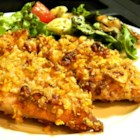 Honey Nut Dipped Chicken  - Chicken pieces are marinated in a sweet and tangy honey mixture, then coated with corn flake crumbs and nuts and baked until golden brown.