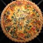 Transformed Spinach Mushroom Quiche - Spinach, mushrooms, feta, and Swiss cheeses fill this moist veggie quiche with flavor. Add sausage if you like. The recipe is easily doubled.
