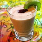 Strawberry Kiwi Smoothie - This strawberry-kiwi smoothie gets a tart kick from orange juice and a little extra sweetness from honey. Perfect for any time of day.