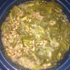 Hoppin' John With Greens - Slow Cooker Recipe - A thick and flavorful dish of black-eyed peas, greens, rice, and a smoked ham hock is sure to bring Southern-style good luck to the new year. Don't forget to leave behind 3 peas in your bowl to stand for luck, fortune, and romance. Serve hot with corn bread.